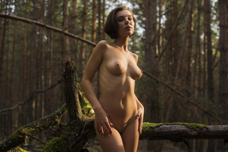 Photo of beautiful nude woman standing